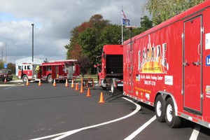 Trucks and equipment line the drive at Alamo Elementary.