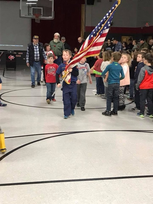 student color guard at Veterans Day ceremony