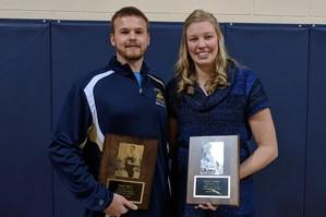 Tommy Brinn (left) and Kelsey Kuipers hold their hall of fame awards.