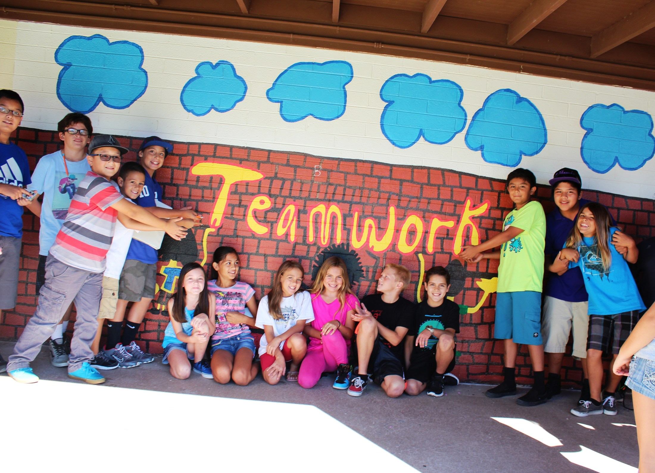 WES Teamwork wall painting sign