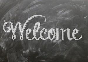 Welcome written on chalkboard