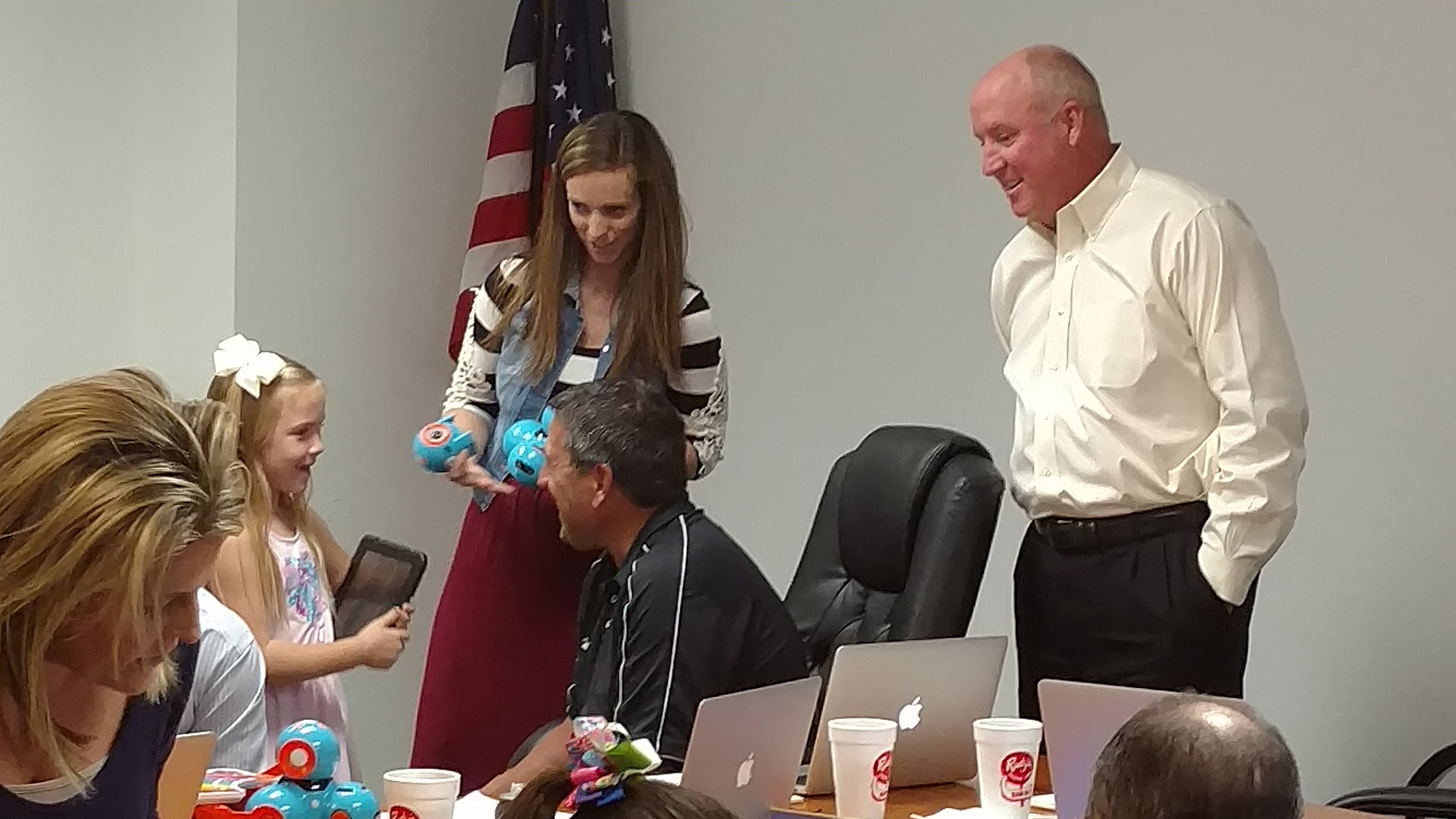 School Board Members learn about the robot, Dash, from CTE first graders