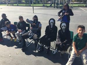 Students enjoying the costume parade.