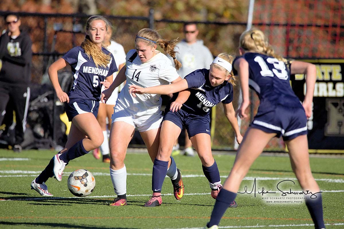 CHS girls soccer player squeezes through a line of defenders