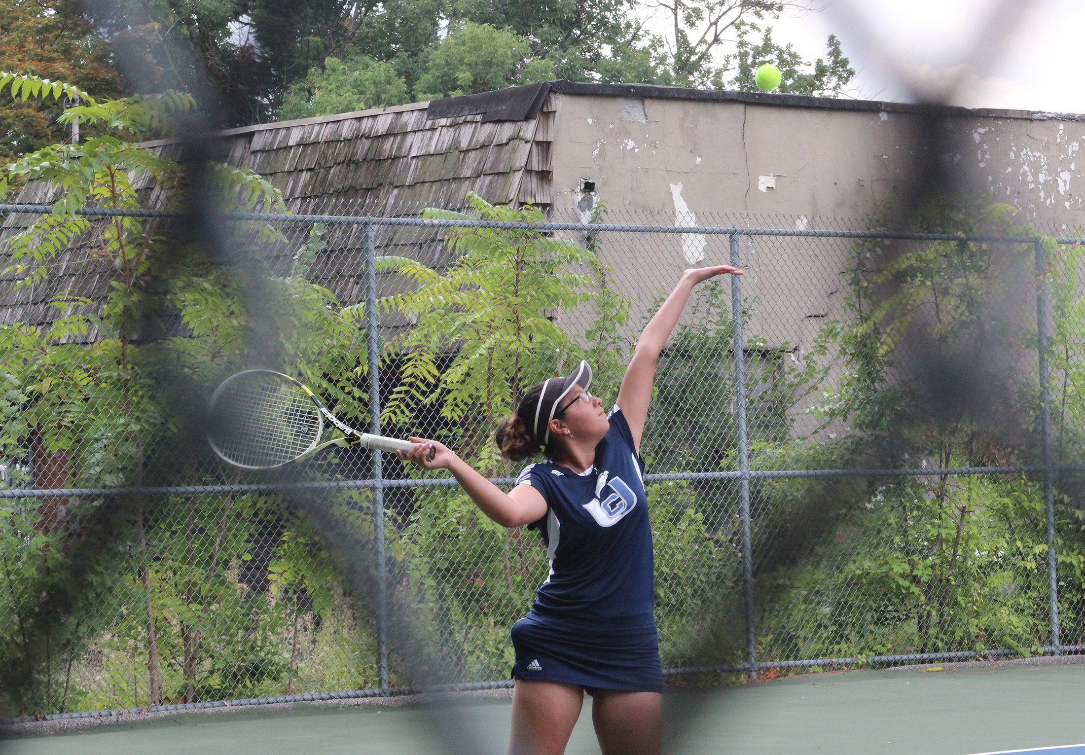 girl tennis serve