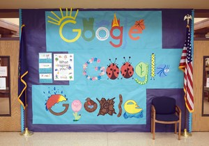 An art display featuring the recreation of three students drawings centered around the word