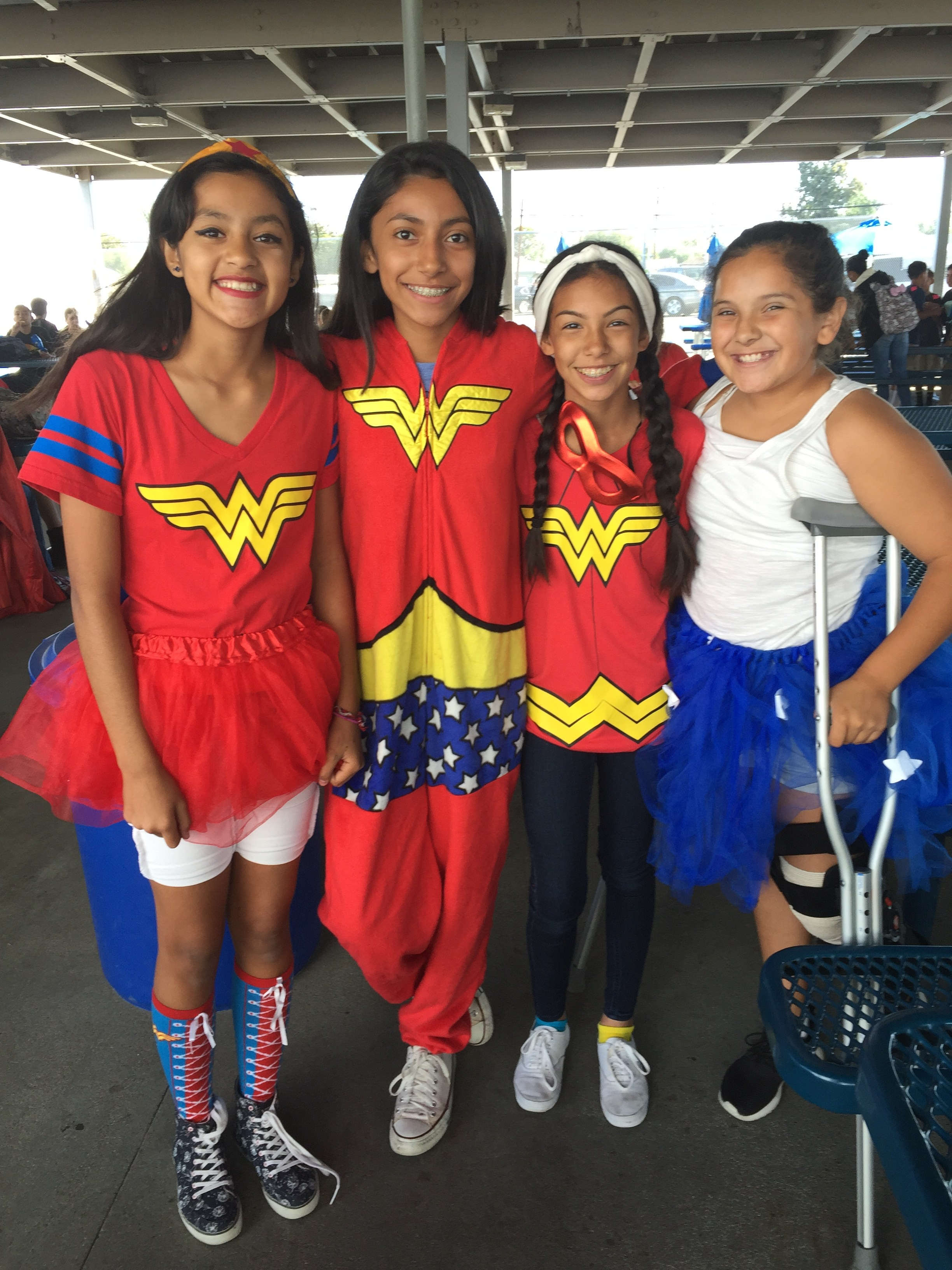 A group of female students dressed up as superheros