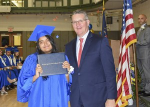 Female student getting her 8th grade diploma
