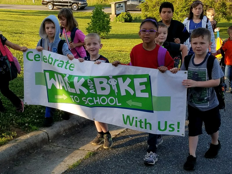 students with walk and bike to school banner