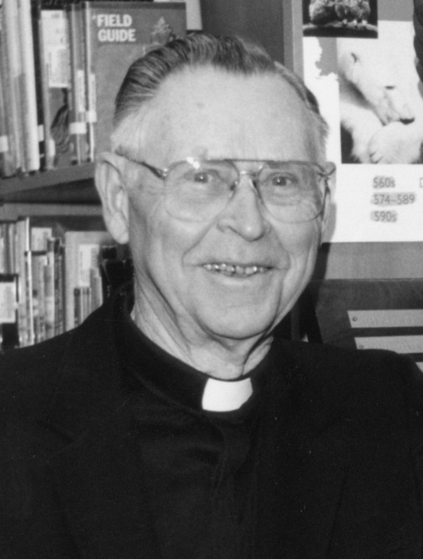 Priest in library