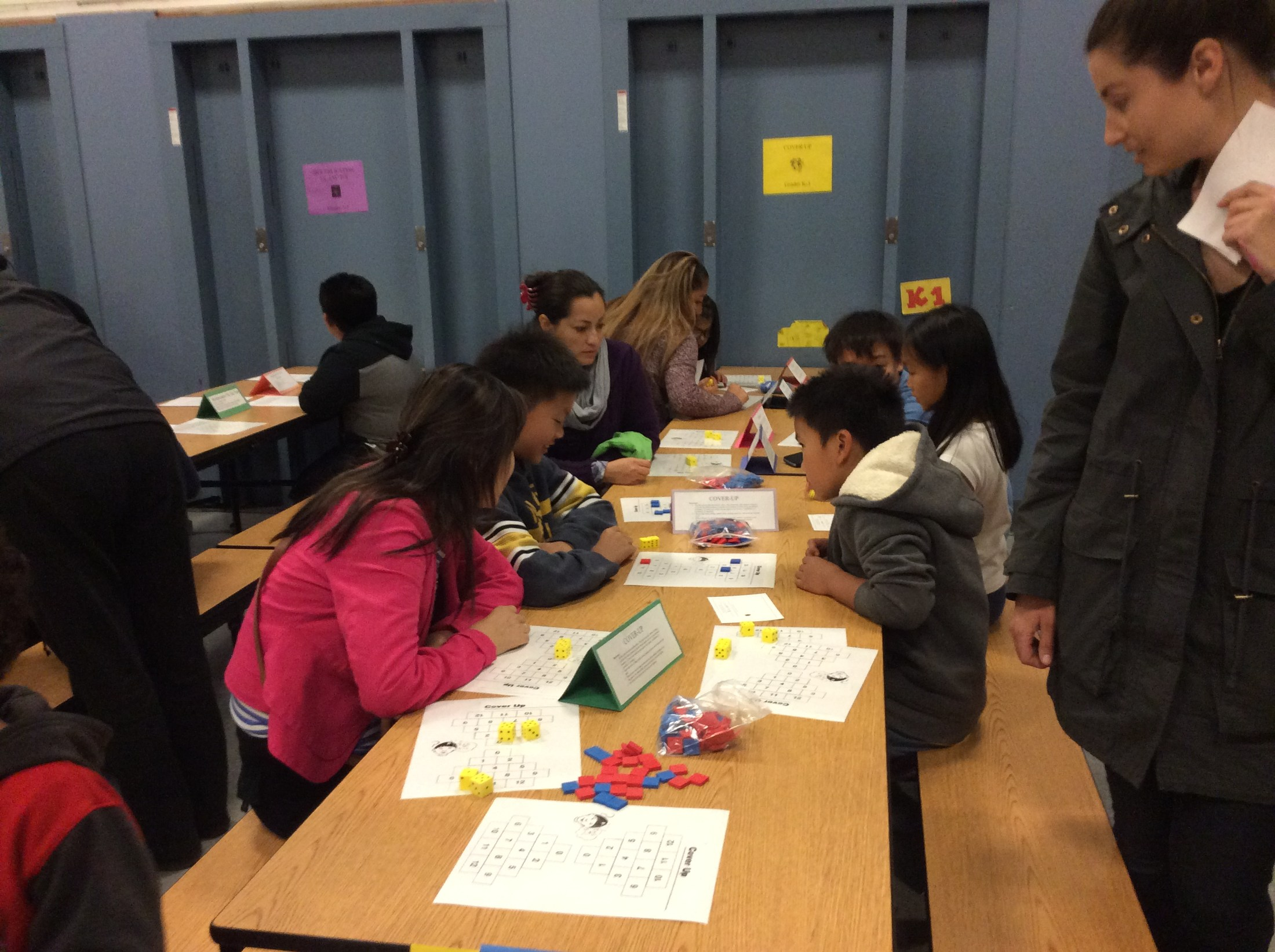 Working together to solve math problems at the family math night.
