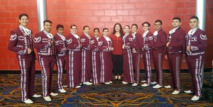 Group picture of the mariachi members in costume.