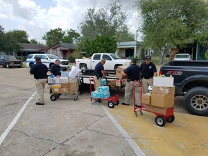 San Benito Law Enforcement gathering the items donated by Landrum Elementary for the victims of Hurricane Harvey