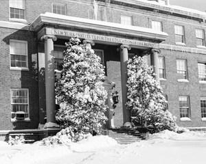 View of Schermerhorn Hall from Pelham Parkway in Winter