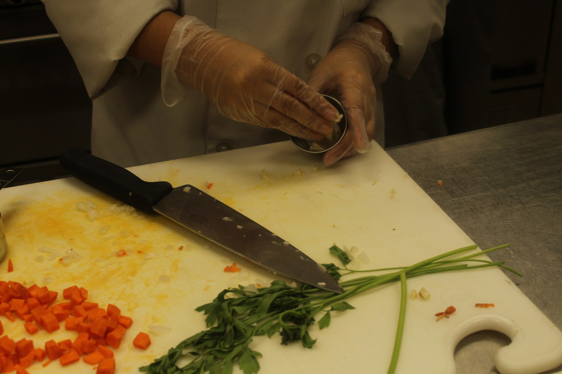 Practicing knife skills by chopping vegetables