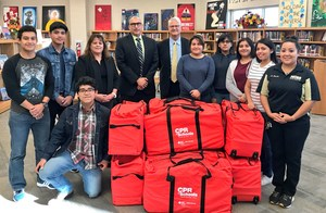 Pictured Mission Collegiate High School students and staff, Dr. Ricardo Lopez (MCISD Superintendent), Martina Carrillo (MCISD Coordinator PE/Health) and Daniel Caldwell ( McAllen Heart Hospital CEO).