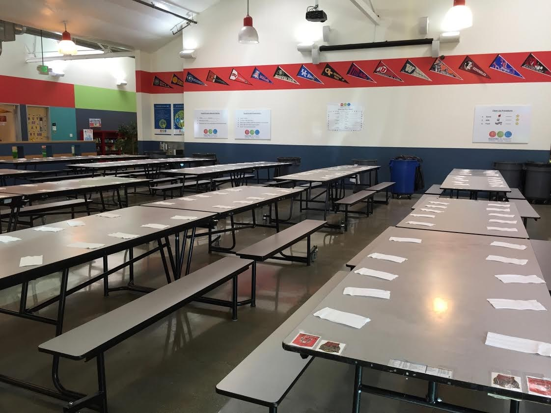 Image of our multi-purpose room at flagship campus, staged for lunch.