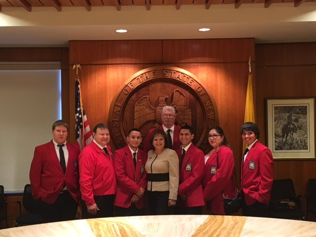 Skills USA students pictured with Gov. Martinez. Pictured L to R: Matt Stephens (CONST), Richard Granger (CRT Adviser), Marrio Coggin (CRT), Ken Burke (Skills USA Adviser), Gov. Martinez, Austin Campos (CRT), Ysabel Pedroza (CONST), Kobie Jojola (CONST).