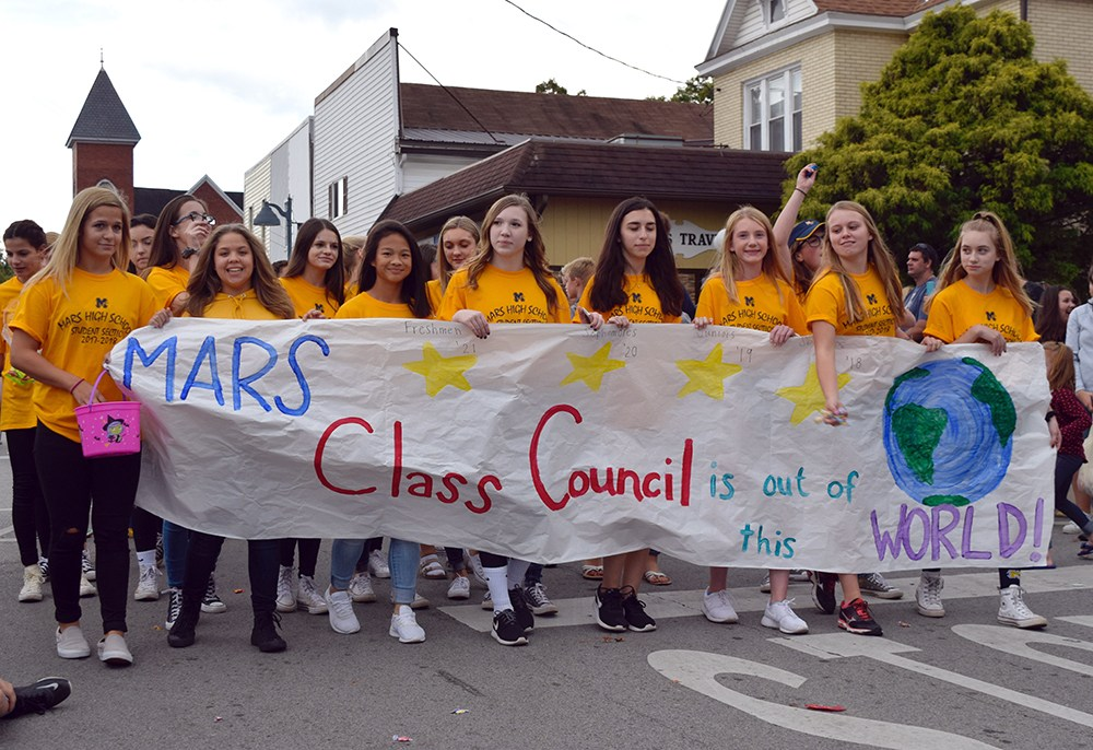 students marching in parade with
