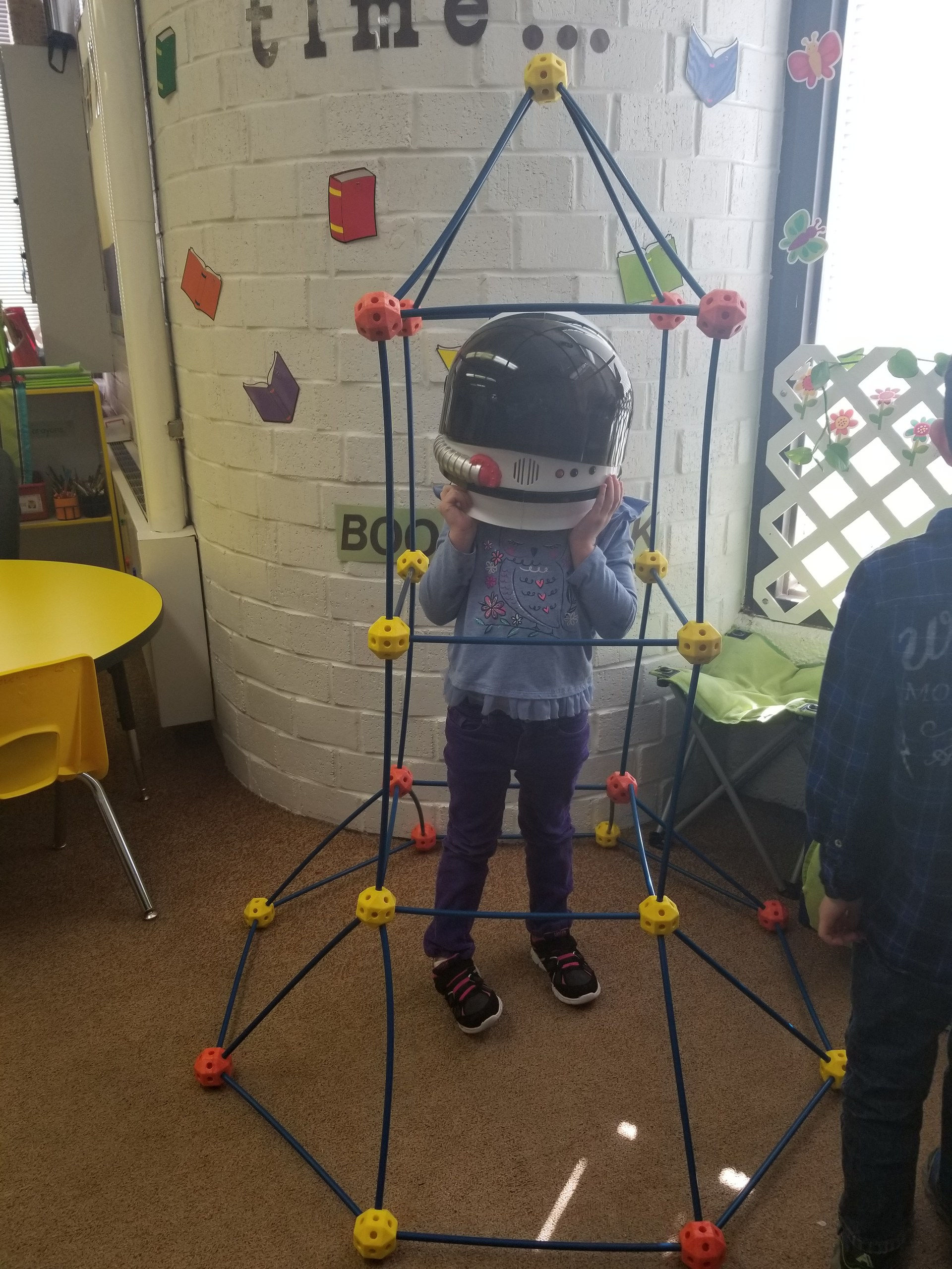 Built a Rocketship and tried on some astronaut helmets.
