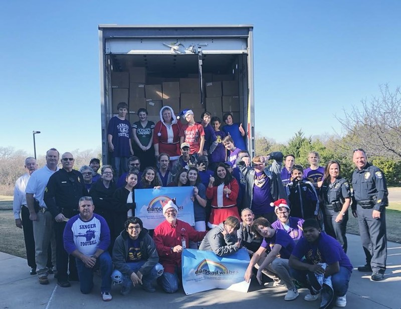 Students and Staff of LTHS with PD unloading toys