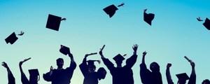 Picture of graduates throwing their graduation caps.