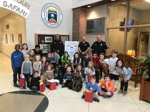 Group of students with gifts to the police and fire department members