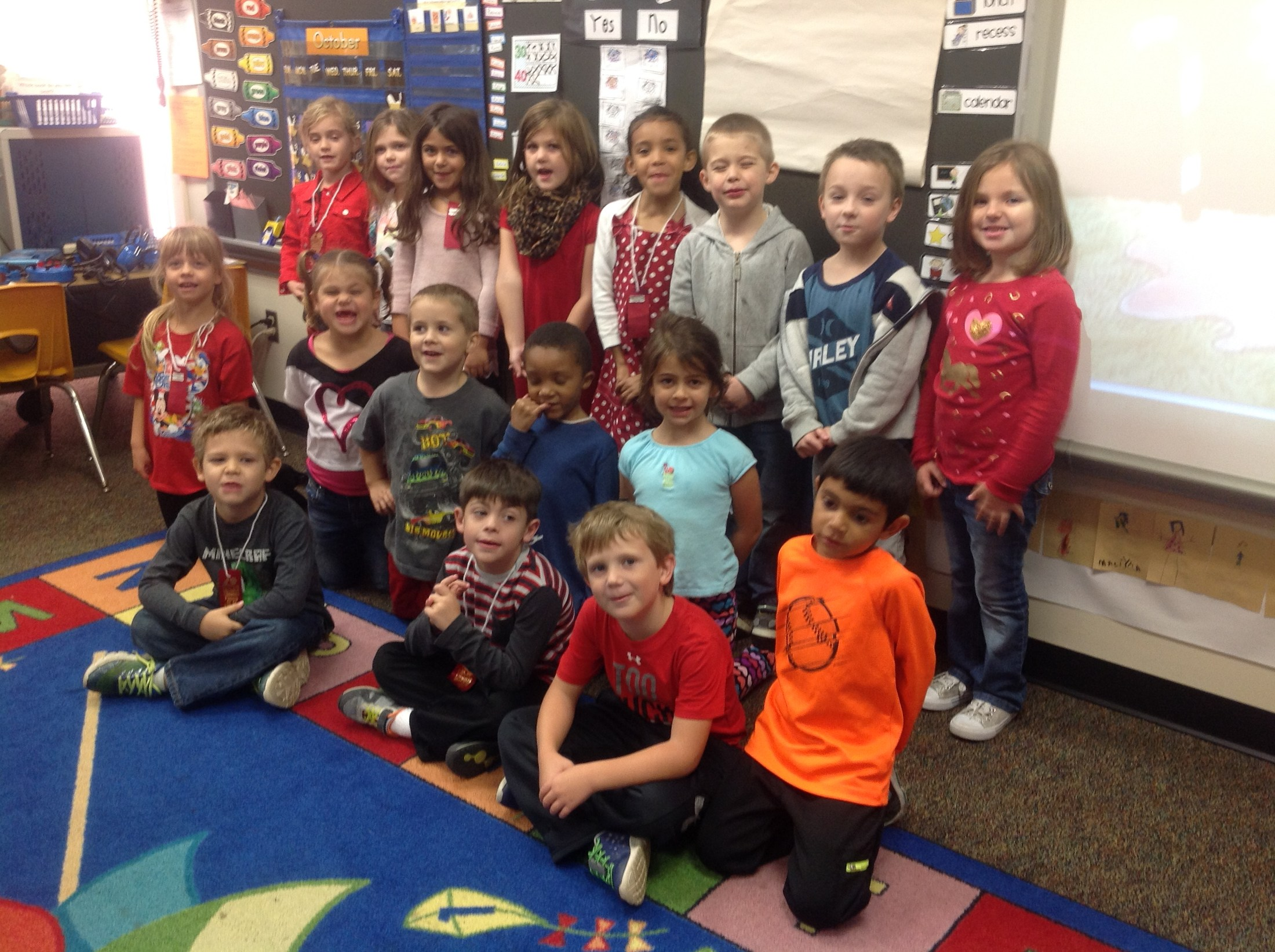 A group of diverse students wear read in support of red ribbon week.