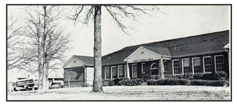 This is a photo of the former Pilot School building, before the new school was constructed.