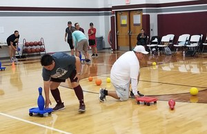 P.E. teachers try a new game in the gym