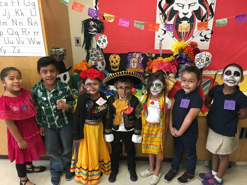 Students in Geddes Elementary School's transitional kindergarten program take part in Día de Los Muertos as part of the school's dual-language immersion program.