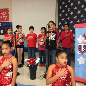 Students saying pledge during ceremony.