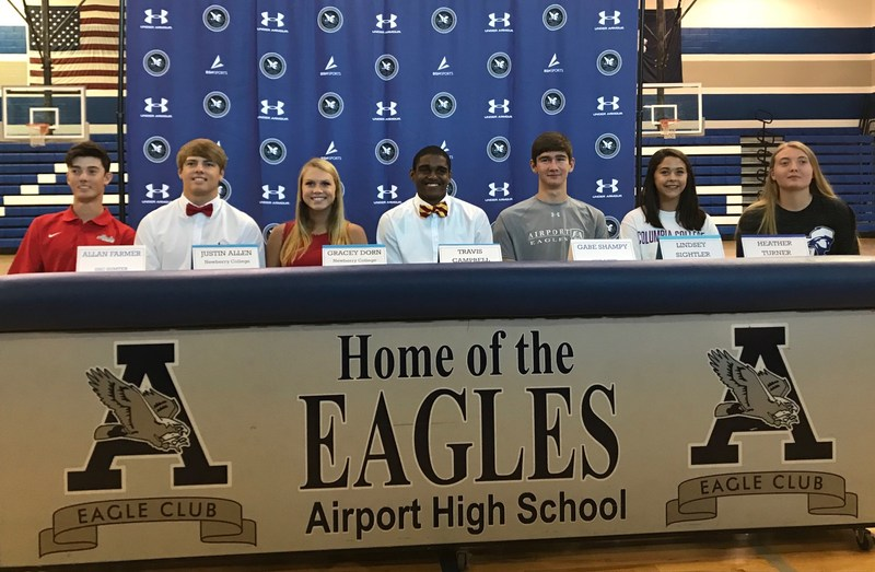 Seven AirportHigh athletes participated in Spring Signing Day -- from left, Alan Farmer, Justin Allen, Gracey Dorn, Travis Campbell, Gabe Shampy, Lindsey Sightler and Heather Turner.