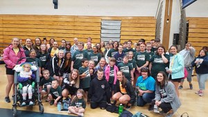 group photo of participants and volunteers for special olympics