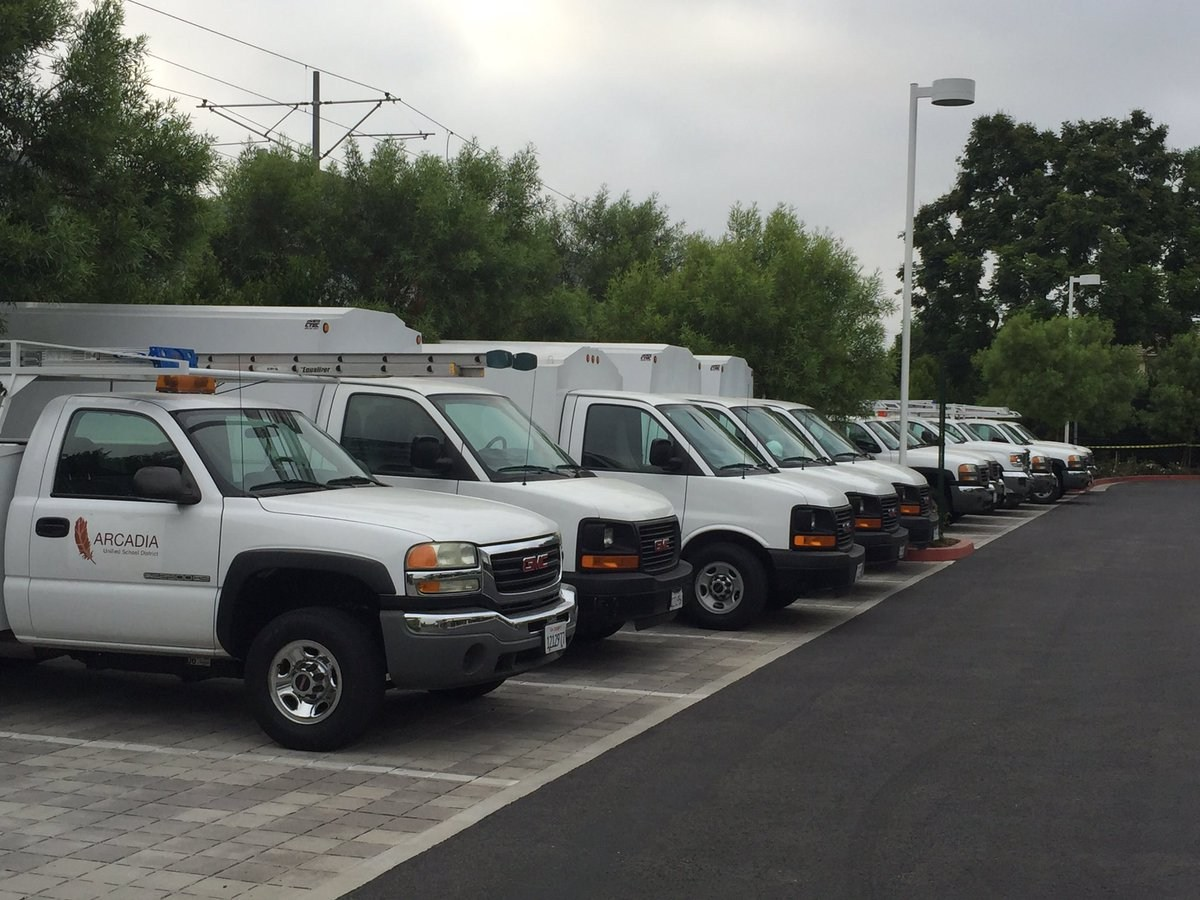 white fleet of trucks