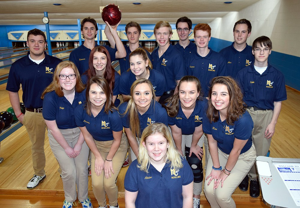 bowling team members posing for photo