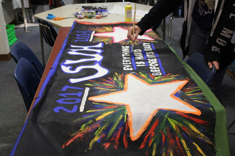 SVH students working on a banner for the parade.