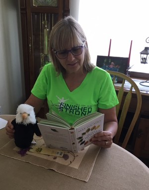 Ms. Gleason reading with Eugene the eagle