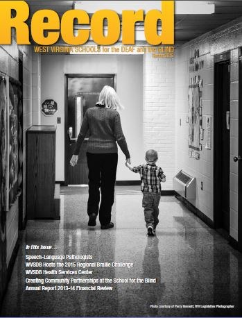 Cover of Spring 2015 Record showing a teacher and student walking hand in hand away through a hall