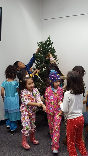Vineland Elementary School students decorate a Christmas tree in the lobby of Baldwin Park Unified's District Office on Dec. 16.
