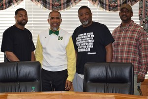 Dr. Cederick Ellis meet with local Barbers to discuss Books in the Barbershop/Literacy.