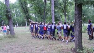 Boys carrying a tree.JPG