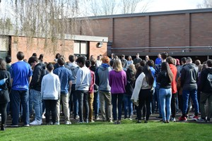 students standing in courtyard
