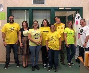 Lairon staff showing off their emoji costumes.