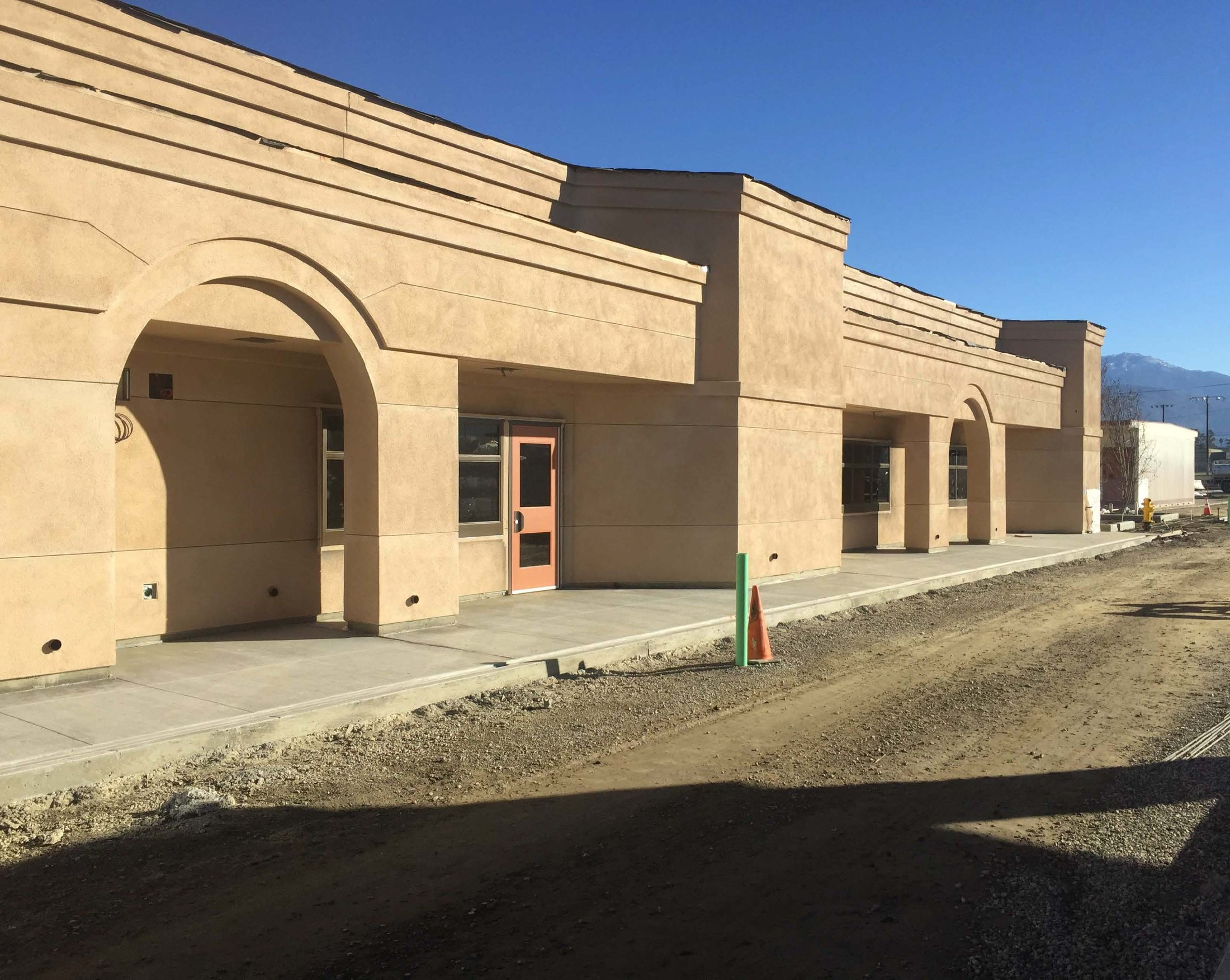 Door Frames, Windows, and Concrete Installed in Building E