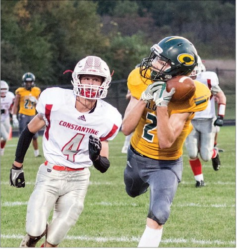 Coloma's Levi Wilkins catches a pass as Constantine's Cody Cookson defends during Friday's game.