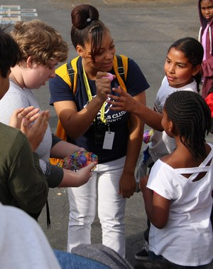 After school teacher helps students find eggs
