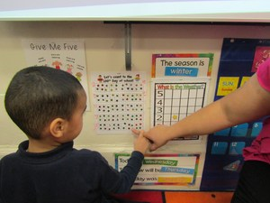 boy counting the 100th day of school