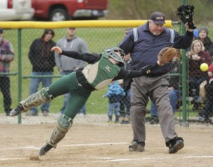 Coloma's Morgan Wagner stretches but can't come up with a foul ball during the first game of a doubleheader against Watervliet Thursday at Coloma High School.