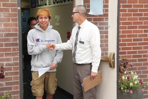PACE High School Principal Paul Zagelow greets students on the first day of school